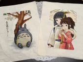 "Cross stitch patterns ""Totoro"" and ""Spirited away""."