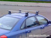 Багажник на крышу Chevrolet Lacetti (sedan, hatchback, universal) - Атлант. Прямоугольные дуги.