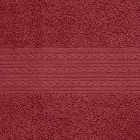 Махровое однотонное полотенце бордового цвета.