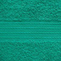 Махровое однотонное полотенце бирюзового цвета.