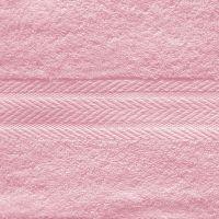Махровое однотонное полотенце светло-розового цвета.