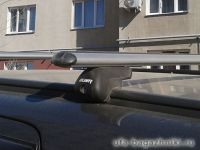 Багажник на крышу Opel Zafira, аэродинамические дуги на интегрированные рейлинги, Атлант