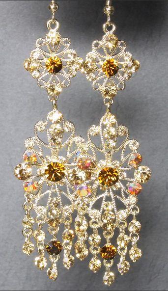 Стильные шумящие позолоченные серьги с кристаллами Сваровски