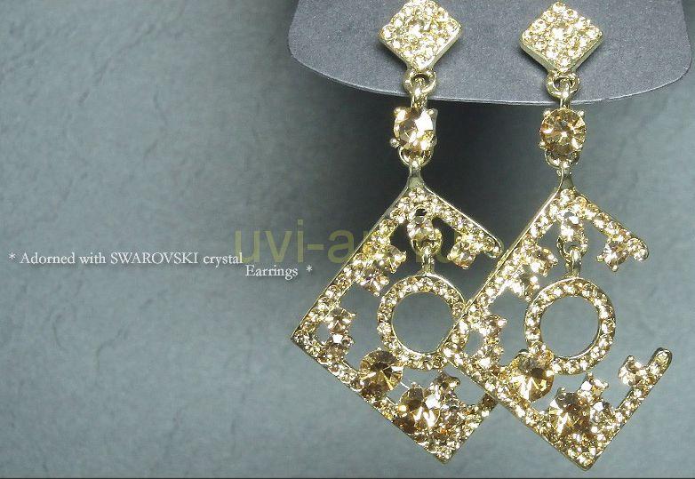 Стильные позолоченные серьги с кристаллами Сваровски