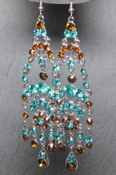 Стильные шумящие позолоченные белым золотом серьги с кристаллами Сваровски