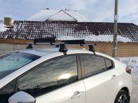Багажник на крышу Kia Cerato, Атлант, аэродинамические дуги, опора Е