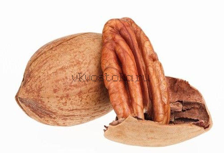 Пекан орех в скорлупе
