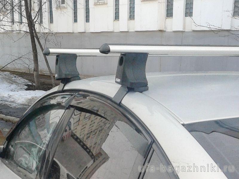Багажник на крышу Volkswagen Passat B5, Атлант, аэродинамические дуги