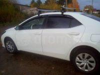 Багажник на крышу Toyota Corolla с 2013 г, Атлант: аэродинамические дуги и опоры типа Е