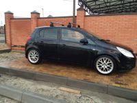 Багажник на крышу Opel Corsa D 2006-..., Lux, аэродинамические  дуги (53 мм)