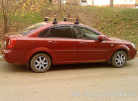 Багажник на крышу Chevrolet Lacetti, sedan - Атлант, Россия. Аэродинамические дуги.
