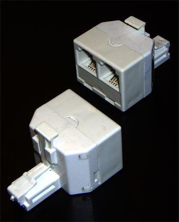 Телефонный адаптер - разветвитель 2 гнезда 6p4c + джек 6p4c T-7002-6p4c