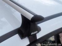 Багажник на крышу Renault Fluence, Атлант, крыловидные аэродуги, опора Е