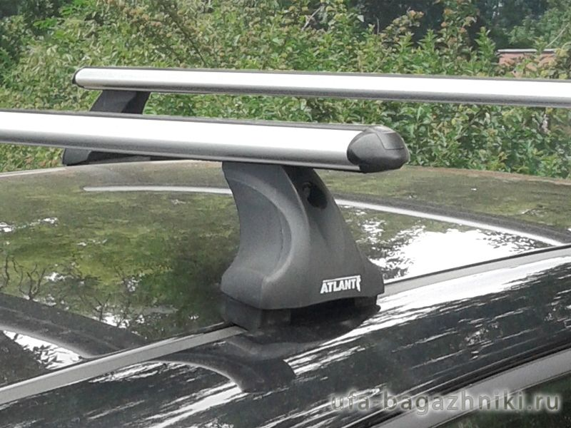 Багажник на крышу Hyundai Solaris hatchback, Атлант, аэродинамические дуги, опора Е