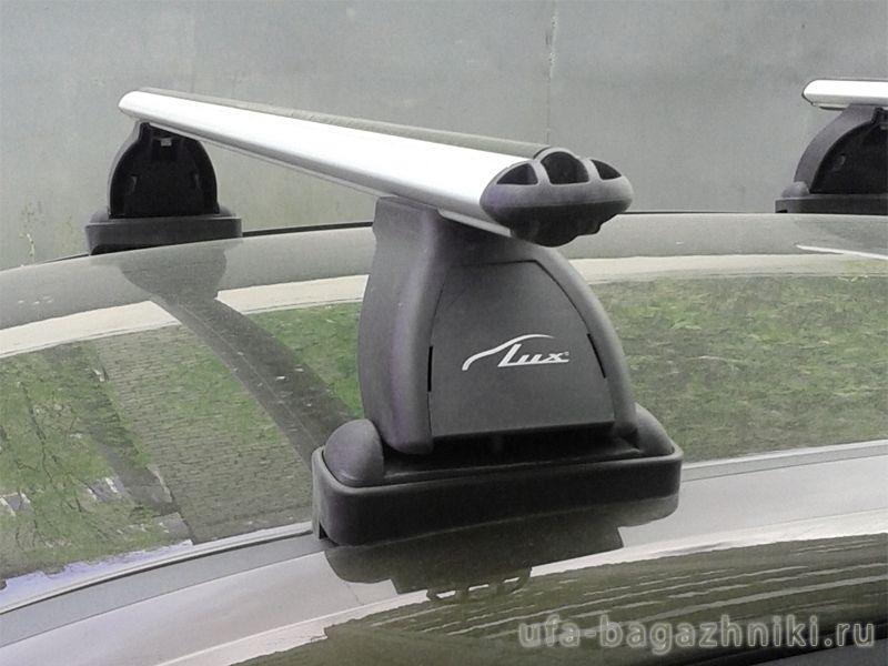Багажник на крышу Hyundai i30, Lux, аэродинамические  дуги (53 мм)