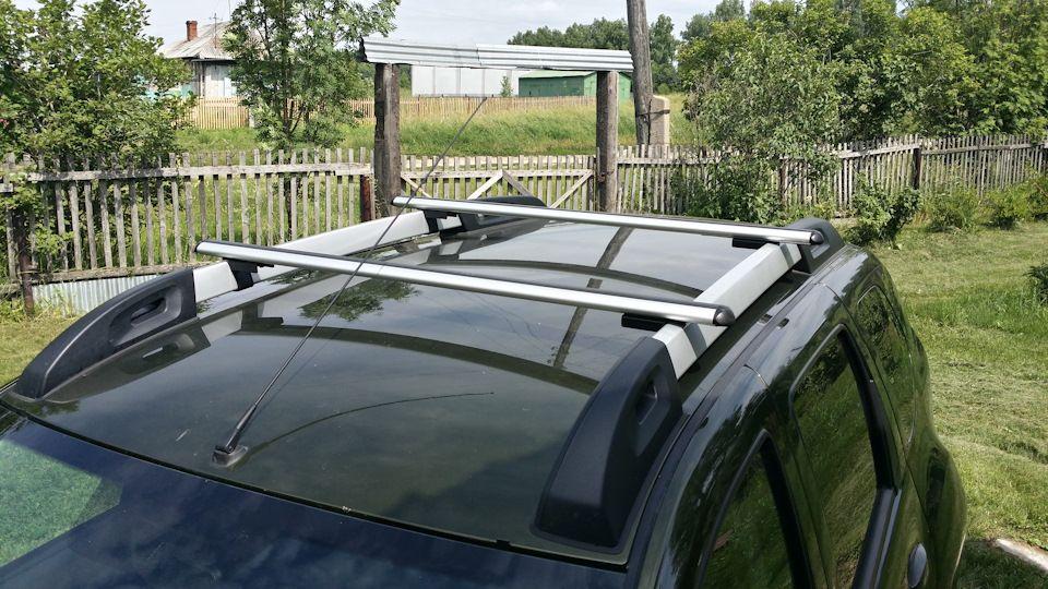 Багажник на крышу Renault Duster 2, Атлант, аэродинамические дуги на рейлинги