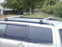 Багажник на крышу Subaru Forester SF 1997-2002, Атлант, аэродинамические дуги на рейлинги