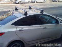 Багажник на крышу Hyundai Solaris, Атлант, аэродинамические дуги