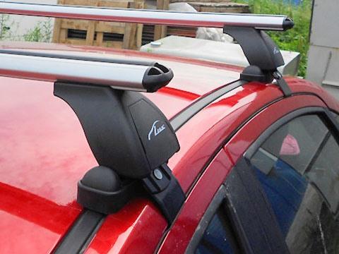 Багажник на крышу Ravon Nexia R3 2015-..., Lux, аэродинамические дуги (53 мм)