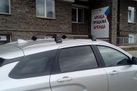 Багажник на крышу Lada Vesta SW / SW Cross, Turtle Air 2, аэродинамические дуги на интегрированные рейлинги (серебристый цвет)