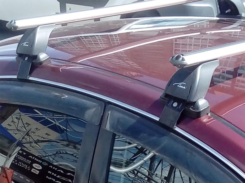 Багажник на крышу Nissan Almera 2012-..., Lux, аэродинамические дуги (53 мм)