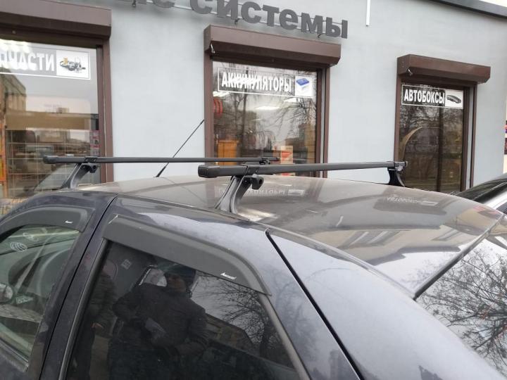 Багажник на крышу на Renault Logan / Renault Sandero (Delta, Россия), стальные дуги
