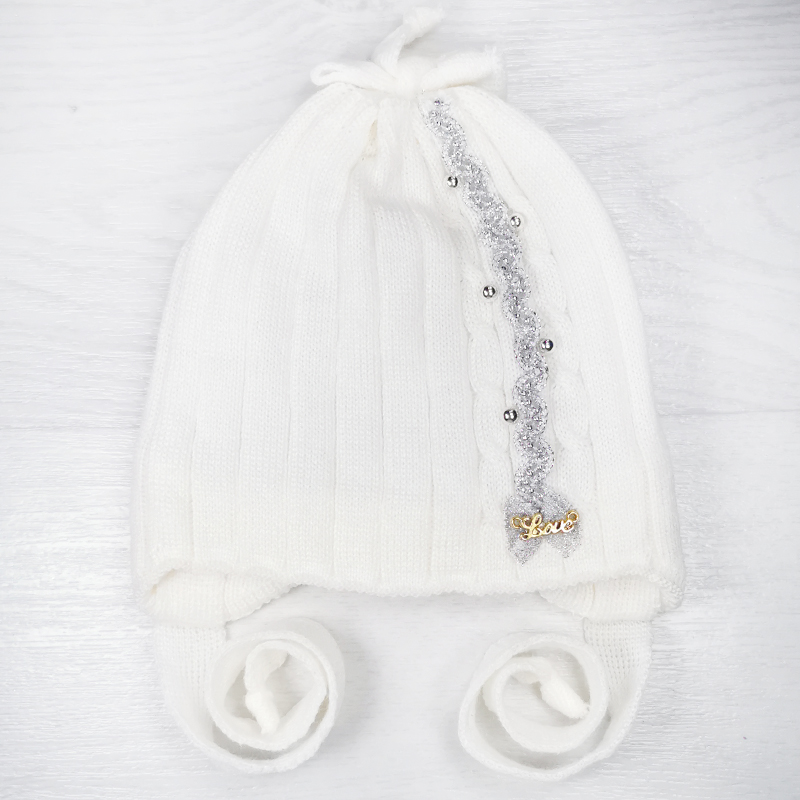 зн1017-32 Шапка вязаная на завязках с бантом на макушке LOVE молочная