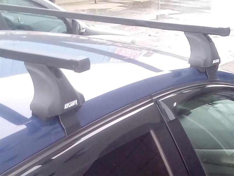 Багажник на крышу Kia Cerato BD 2018-..., Атлант, стальные прямоугольные дуги (в пластике)