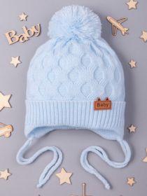 РБ 17572 Шапка вязаная для мальчика с бубоном на завязках, нашивка baby, голубой