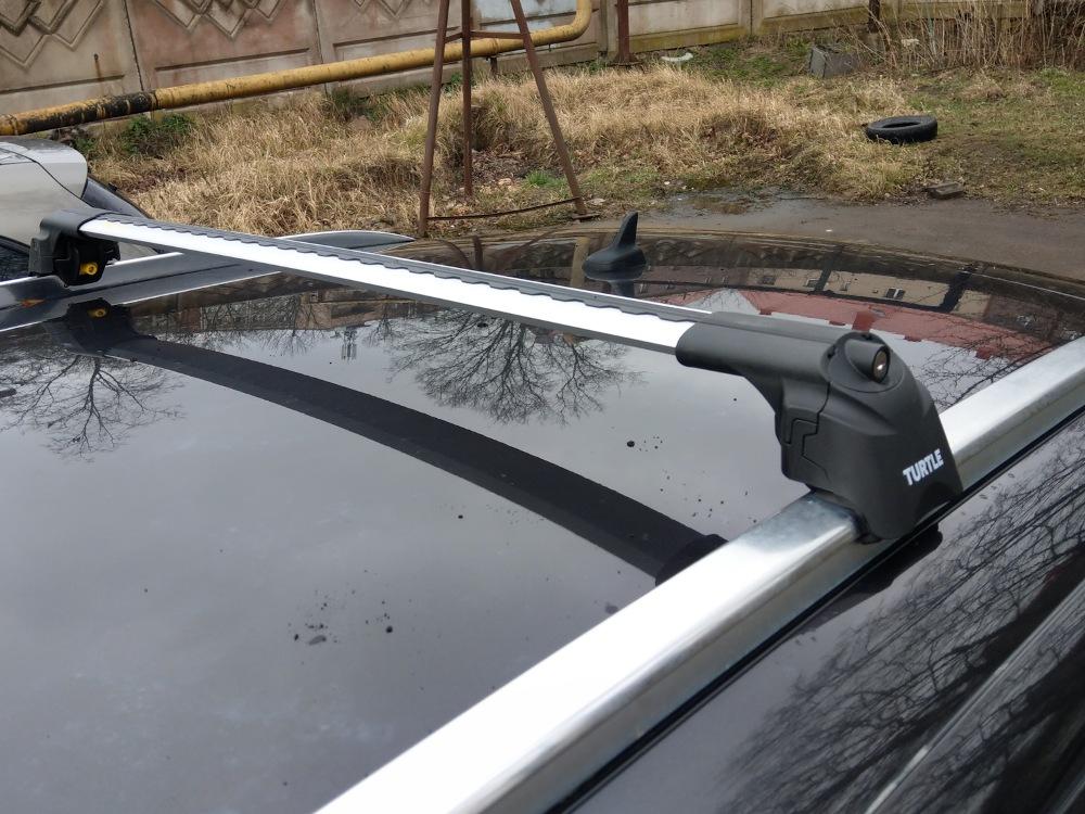Багажник на крышу Audi Q7 2005-2015, Turtle Air 2, аэродинамические дуги на интегрированные рейлинги (серебристый цвет)