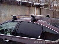Универсальный багажник на крышу D-Lux 2, крыловидные дуги