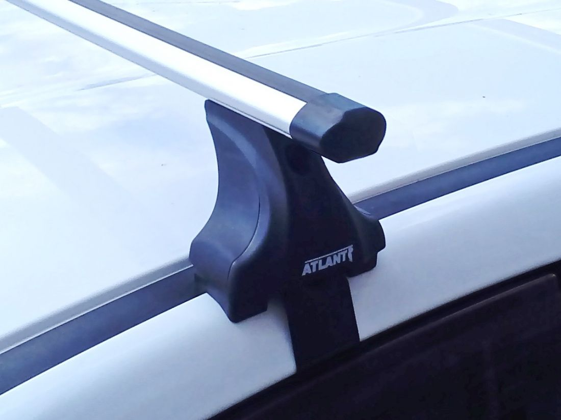 Багажник на крышу Kia Rio (2011-2017), Атлант, аэродинамические дуги Эконом, опора Е