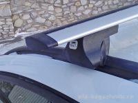 Багажник на интегрированные рейлинги Opel Astra Sports Tourer, Amos, крыловидные дуги